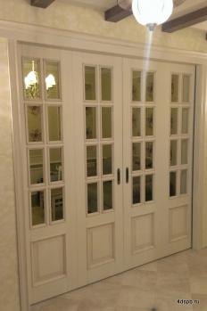 Раздвижная перегородка из четырех откатных дверей